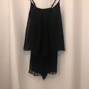 Black flowy romper on top and lace shorts